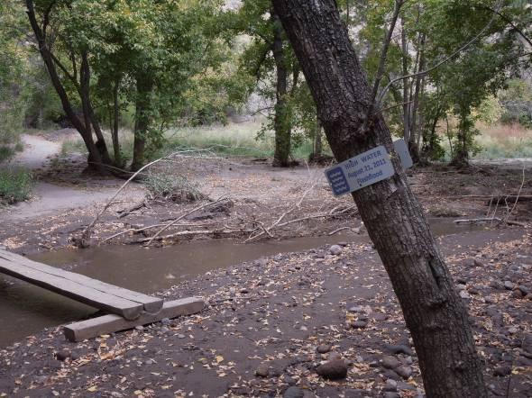 Footbridge across Frijoles Creek and high water mark.