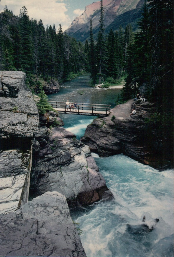 Above St. Mary Falls: footbridge, and St. Mary River continuing beyond