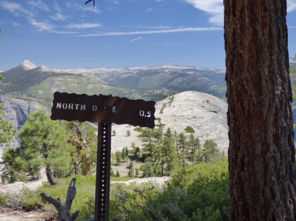 Mileage sign with North Dome beyond